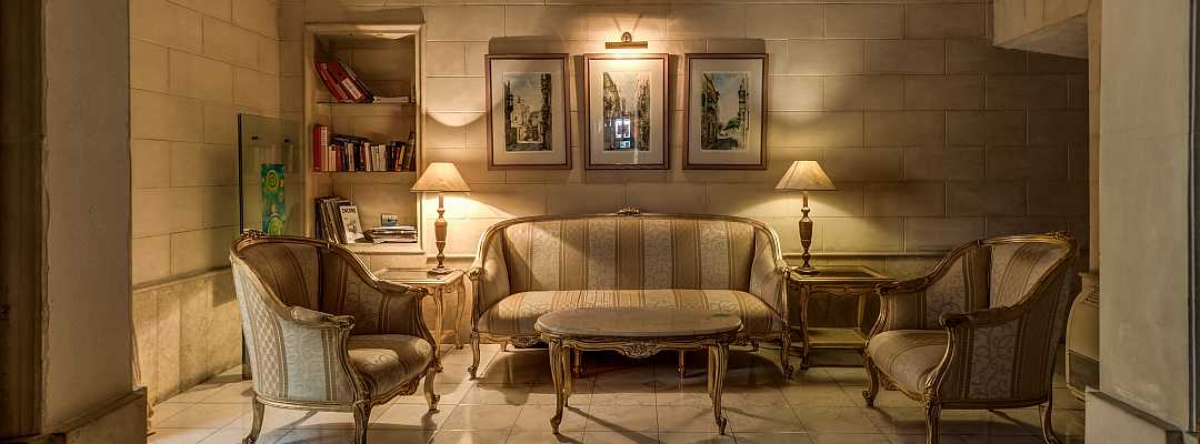 Elegant and welcoming sitting room at the entrance of Castille Hotel