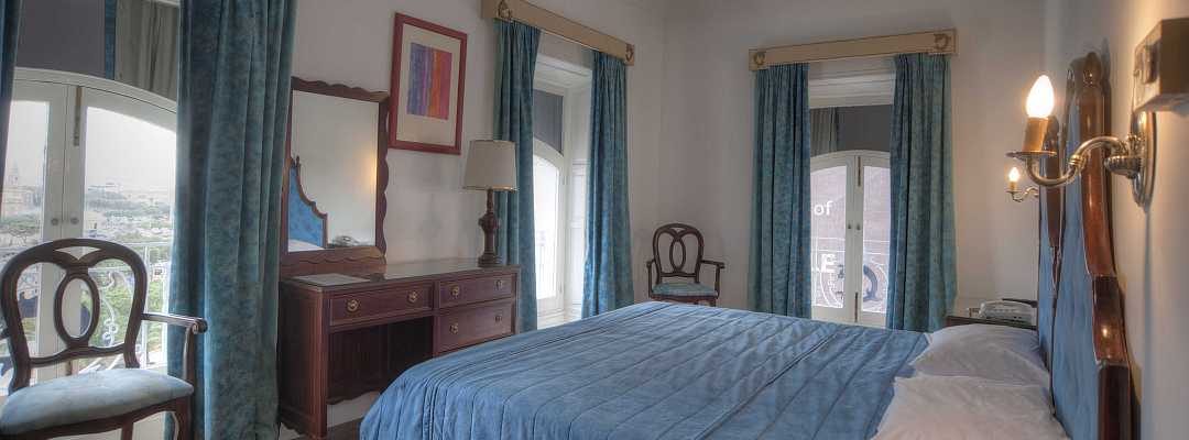 Spacious and bright Three Window room at Castille Hotel