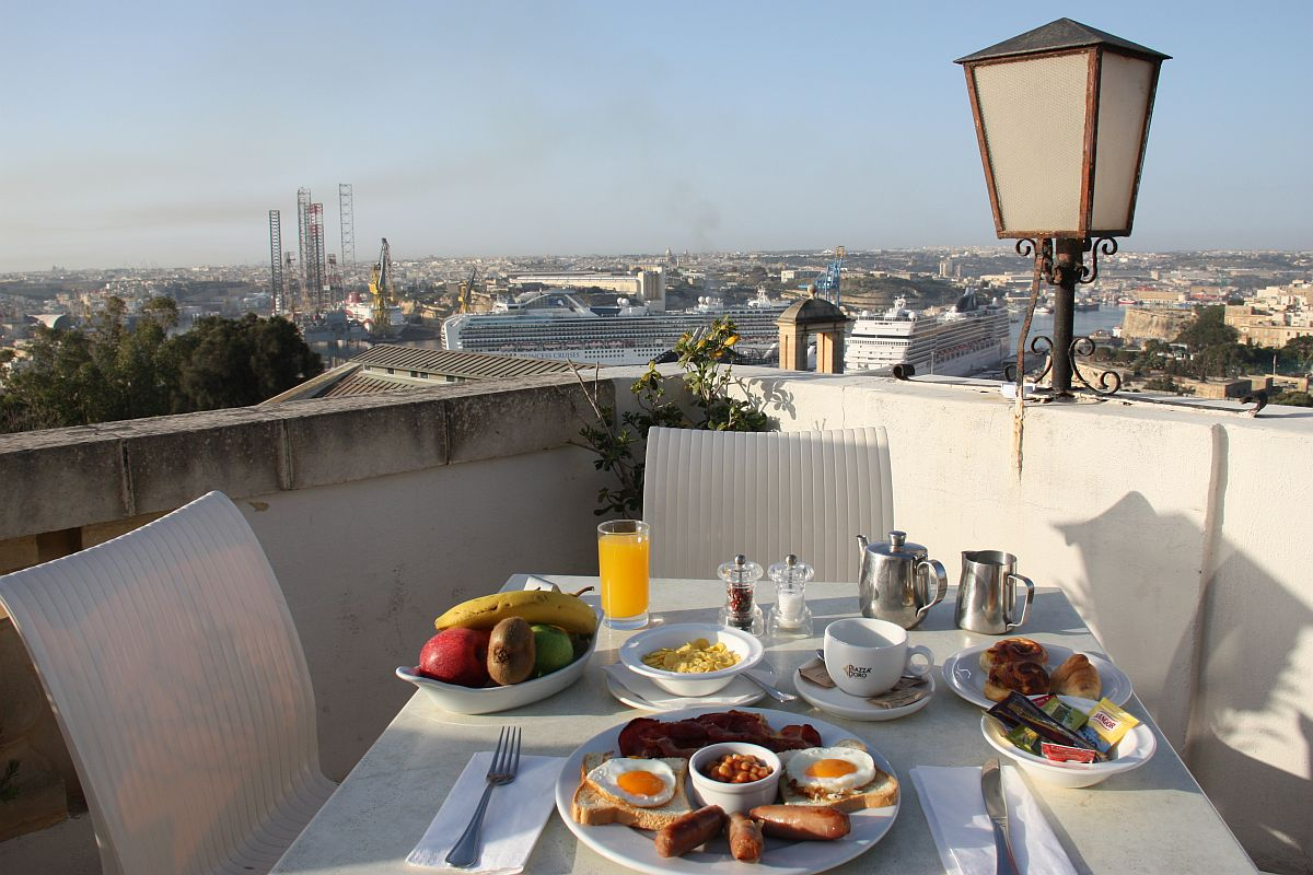 Breakfast whilst enjoying a magnificent view of the Grand Harbour