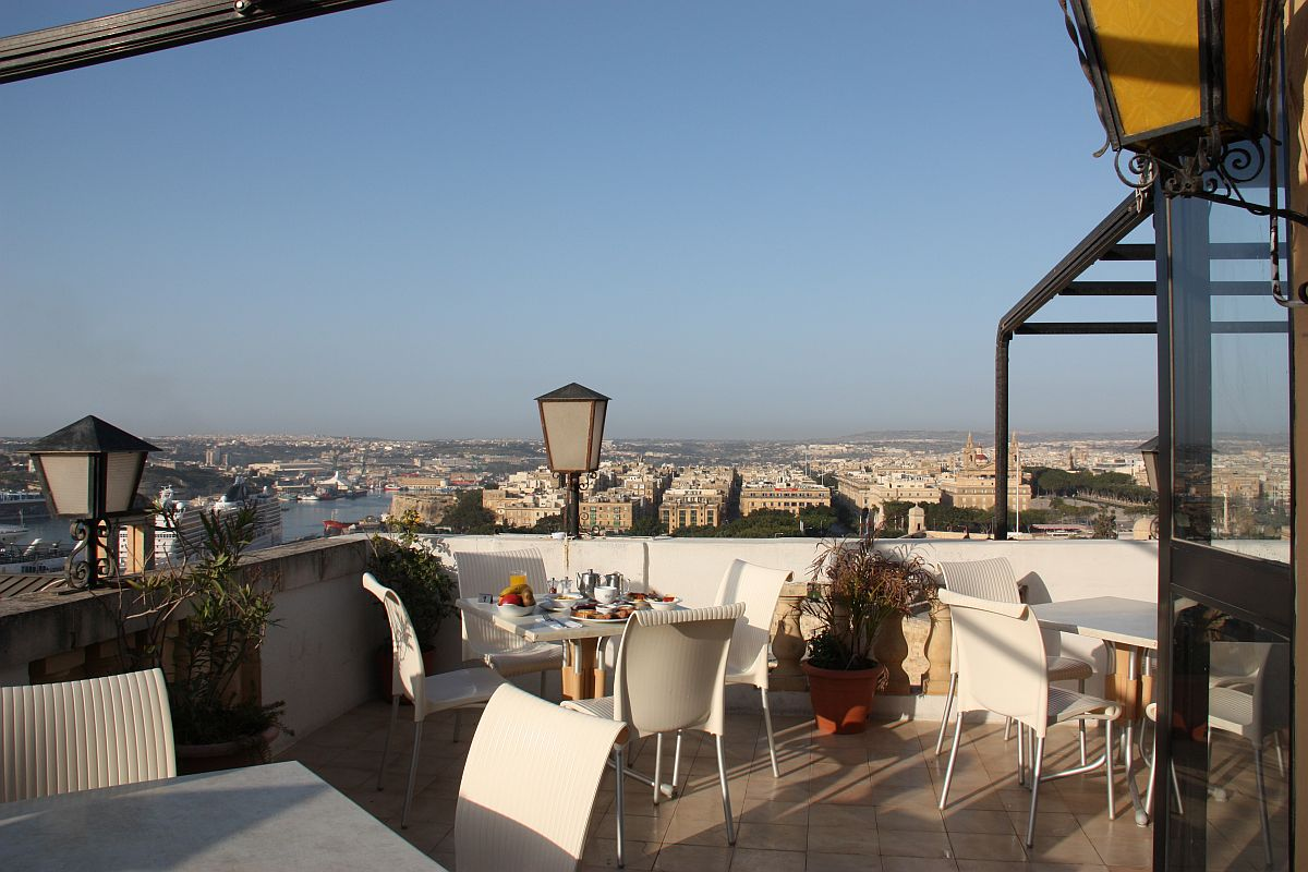 Open-air terrace dining area has spectacular views of Valletta, The Grand Harbour and surrounding towns