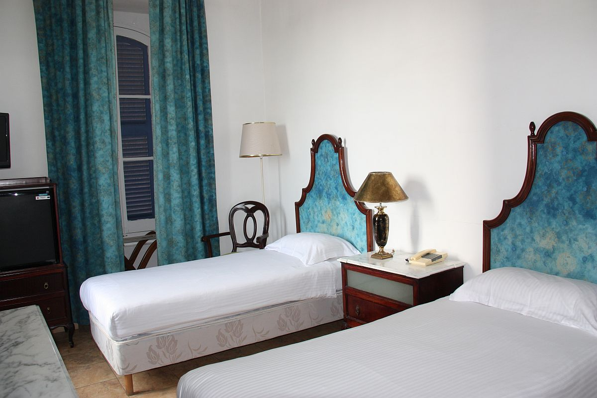 Twin room with tradional Maltese balcony at Castille Hotel