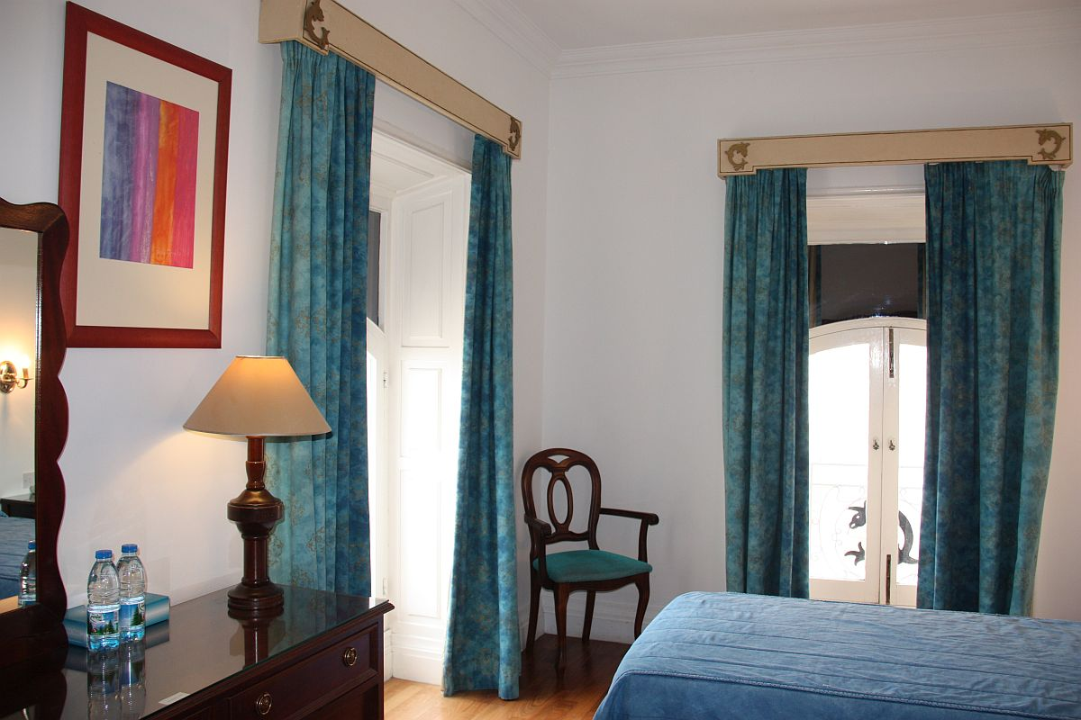 Twin room with traditional Maltese balcony at Castille Hotel