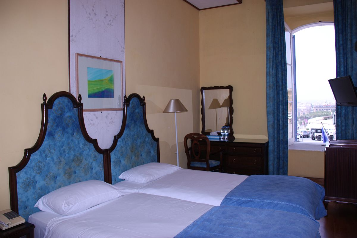 Spacious and comfortable Standard Twin room at Castille Hotel overlooking Castille square